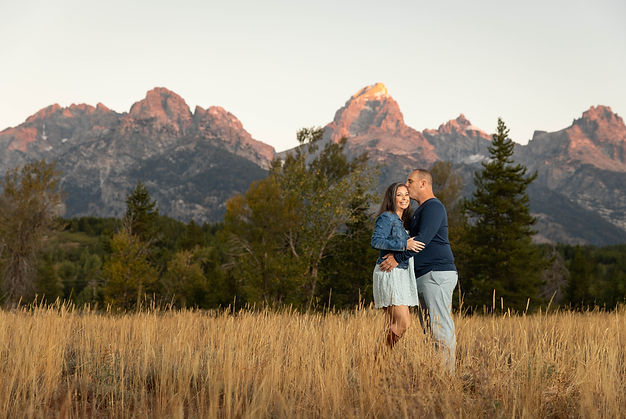 A photo of two people getting their engament photo taken in the Grand Tetons
