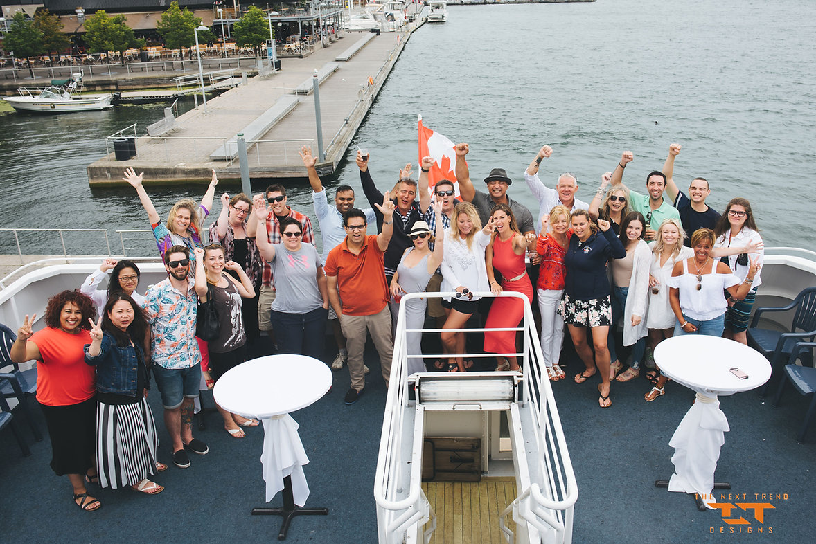 The employees of TNT on a boat cruise