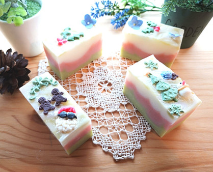 Christmas Art Soaps decorated with Christmas theme confetti made from soap clay