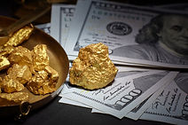 nugget gold and dollar bills, business c
