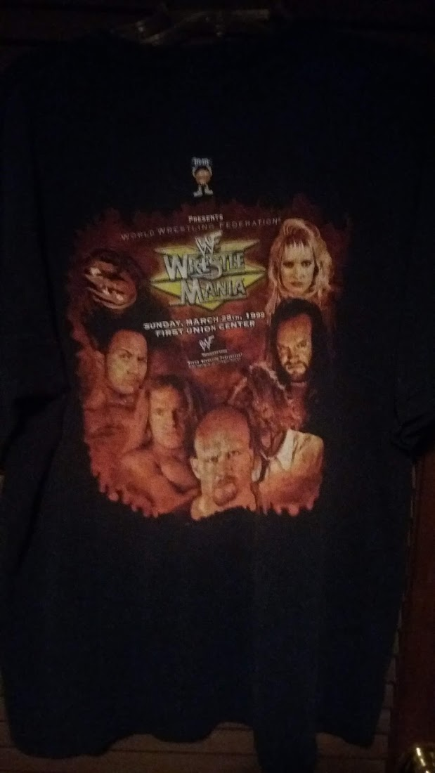 Back of WrestleMania 15 shirt