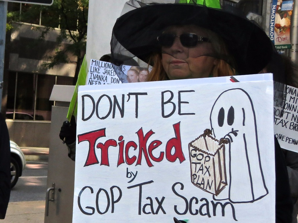 Oppose Trump's tax-cuts for the rich. Harrisburg residents protest at Senator Toomey's Pennsylvania office.