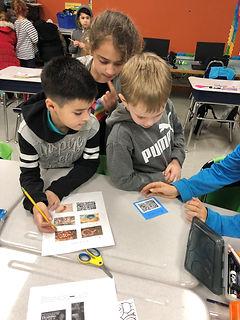 kids looking at microorganisms.jpg