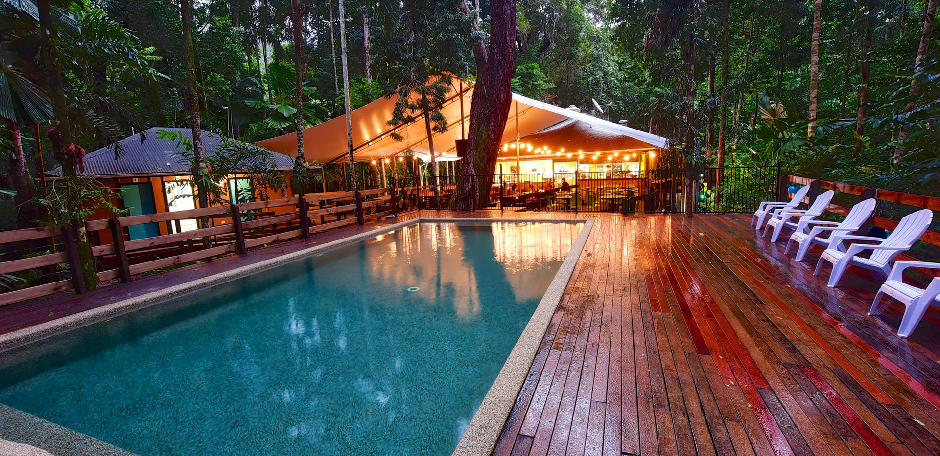 Cape Trib Beach House outdoor pool and Tides Bar & Restaurant