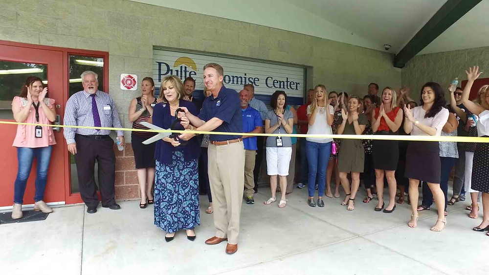 Irene Rickus, CEO of the Children's Home Network and Pulte Homes West Division President Sean Strickler recently cut ribbon at the renovated vocational building renamed Pulte Promise Center.