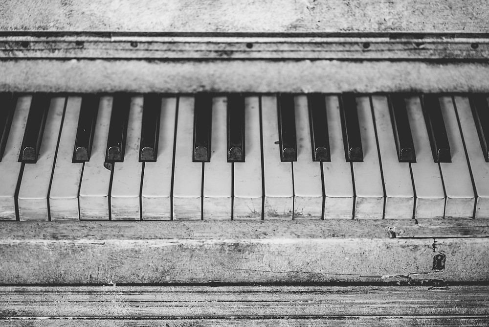 black and white image of a piano
