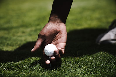 person-holding-golf-ball-1325749.jpg