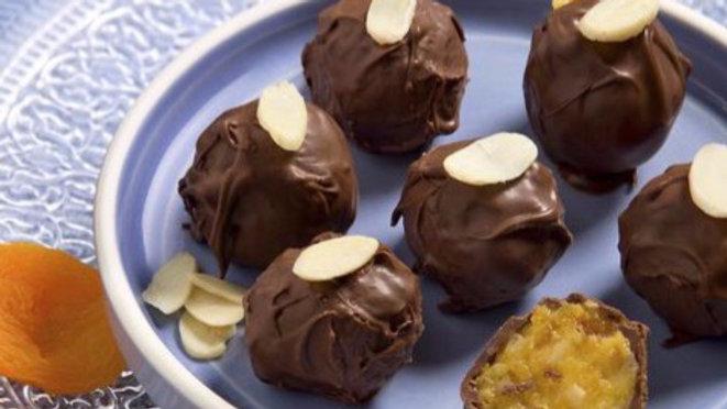 Trufa de damasco, castanha e chocolate