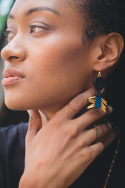 shaggy earrings and pyramid rings
