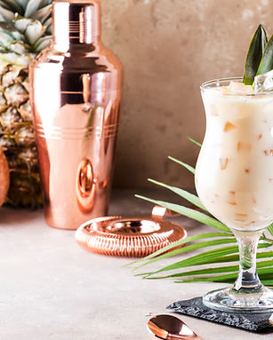 Pina Colada Cocktail on sand beige backg