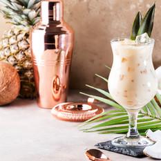 Pina Colada Cocktail on sand beige backg