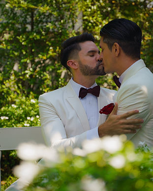 gay bride and groom in white suit happy