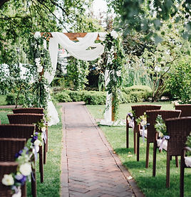 Wooden wedding arch  decorated by white