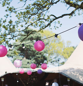 Round paper lanterns hung up at a tipi w