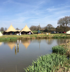 Event tipis by a lake.jpg