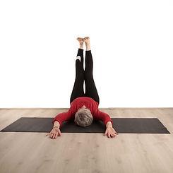 "Yoga teacher posing in ""Legs up the wall"""