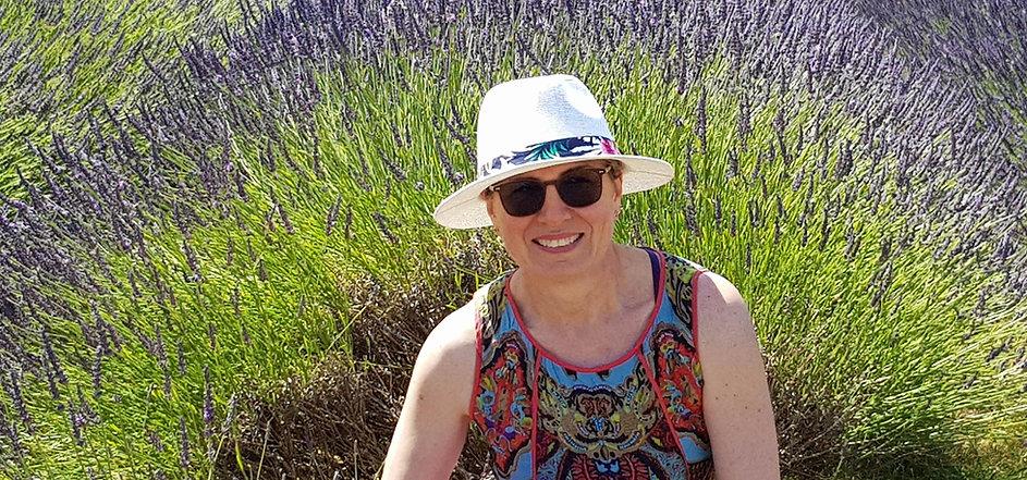 Yoga teacher portrait sitting in a lavendar field