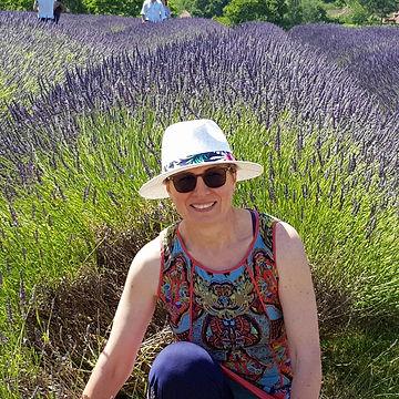 Yoga teacher sitting the lavendar fields. Portrait