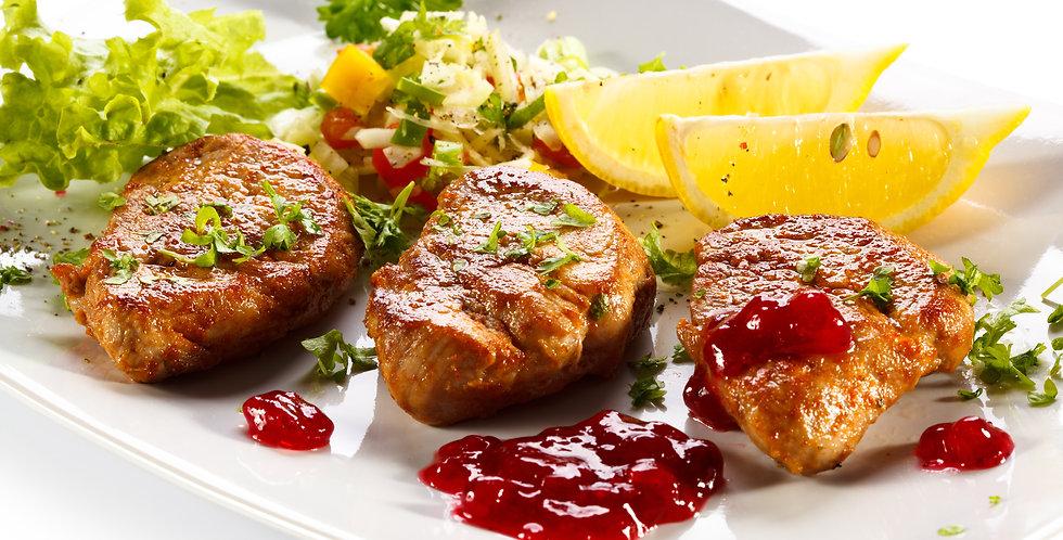 Herb Marinated Boneless Pork Chops with Morello Cherry Sauce