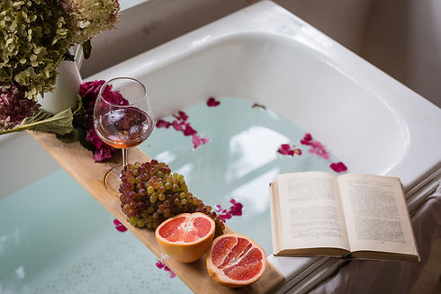 Bath tub with flower petals, grapefruit