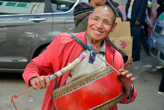 20. Drummer at a funeral procession, Yua