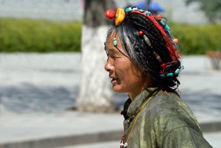 24. Woman wearing traditional Kham jewel