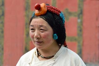 23. Woman wearing traditional Kham jewel