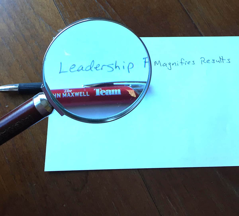 Leadership focus with magnifying glass