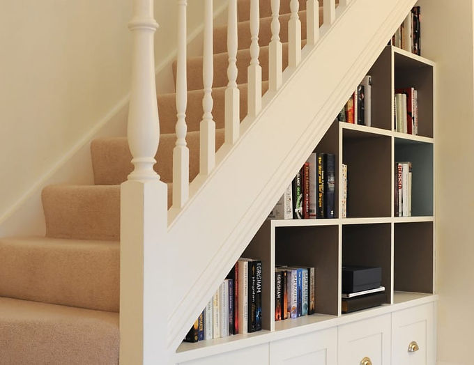 Bookcase and display under the stairs