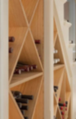 Custom fitted wine rack, built in under the staircase