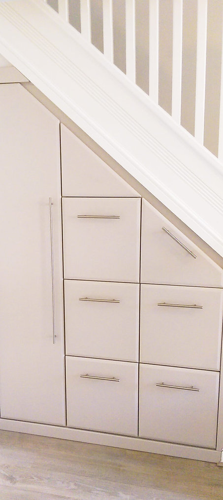 Modern drawers fitted under the stairs