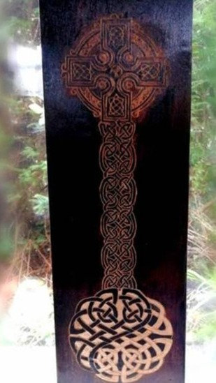 Wooden cross and Celtic Knot on hardwood by Fiona Melford