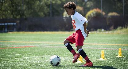 OSU-gallery-soccer-boydribble.jpg