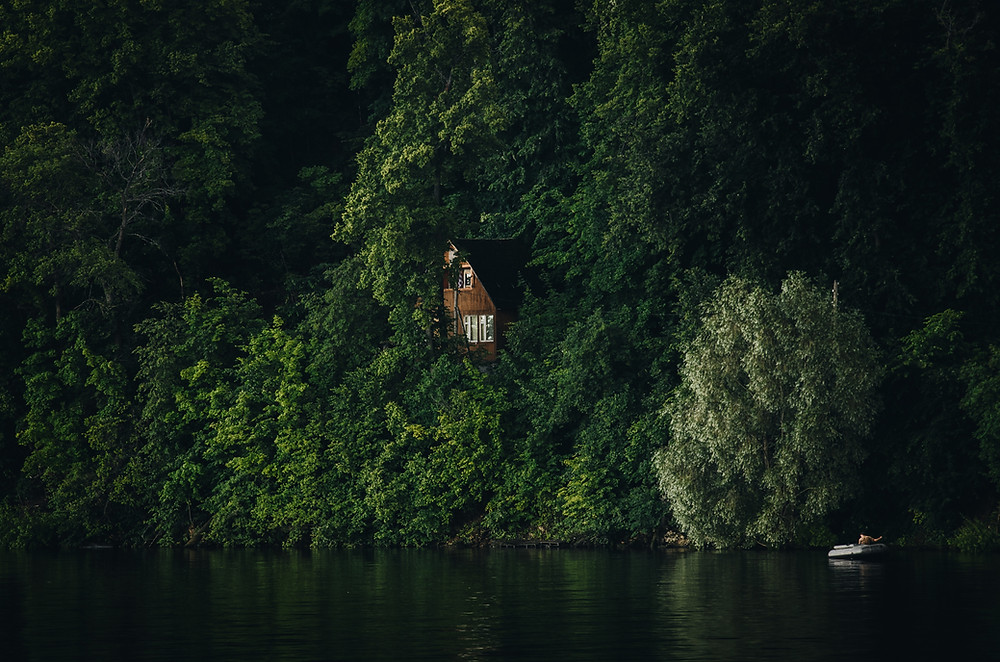 'The house next to the lake, ON a cliff'