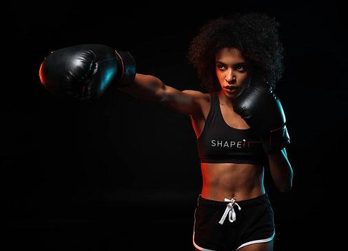 woman wearing shapeit gym and street wear sports bra
