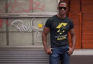 Cool black man wearing sun glasses and wearing shapeit gym & street wear t-shirt