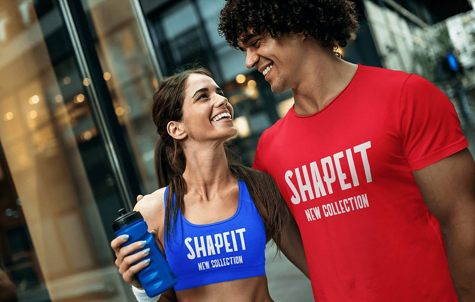 man and woman wearing shapeit gym and street wear t-shirt and sports bra
