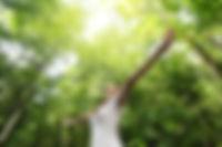 Enjoying the nature. Young woman arms ra