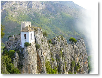 White bell tower in Guadalest