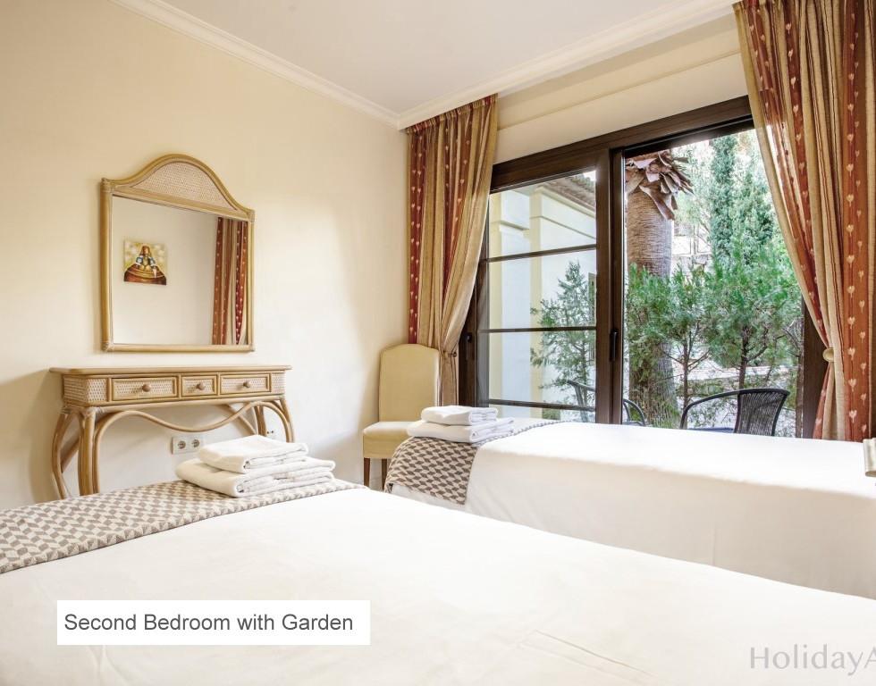 09 SECOND BEDROOM WITH GARDEN.jpg