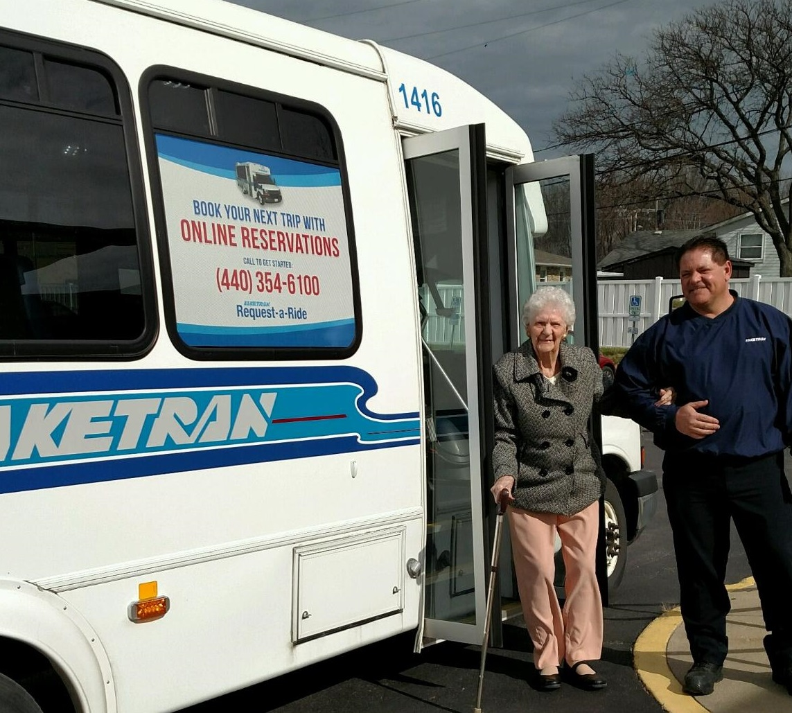 Laketran-Dial-a-Ride-driver-assists-Senior
