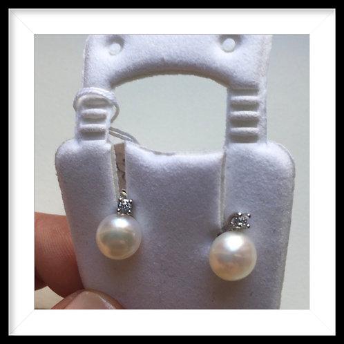 Orecchini  perla e punto luce