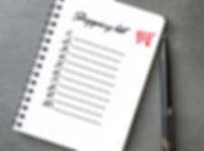 Shopping list written on notebook, grey