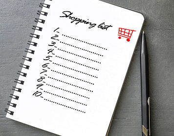 Shopping list written on notebook, grey