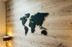 metal world map on wooden wall