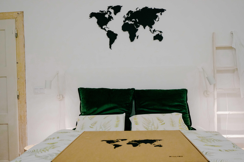 metal world map in bedroom