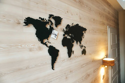 Pinned photo on metal world map