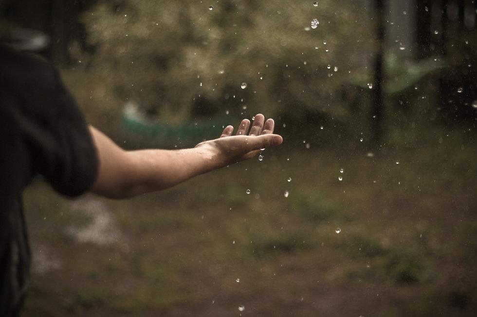 holding-hand-in-the-rain-XWJ9ZP3_edited.