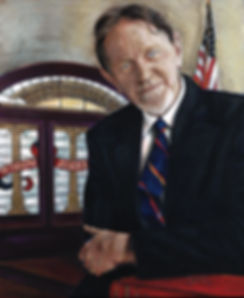 TLNPG inductee Bobby Lee Cook arms folded standing in the Georgia Supreme Court