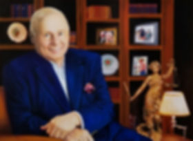 TLNPG Inductee Tom Girardi sitting in his office at Girardi & Keese seated in front of his bookshelf with books and a photo of him and his wife Erika Jayne